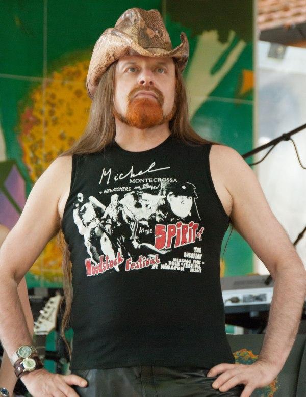 Michel Montecrossa models self-designed legendary Spirit of Woodstock Festival in Mirapuri T-Shirt